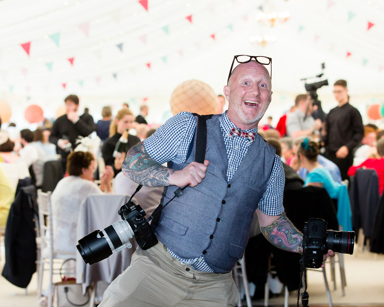 Photo of Chris Scott with his camera equipment at an event.